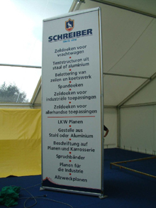Here is an advertising totem with painted lettering on tarpaulin