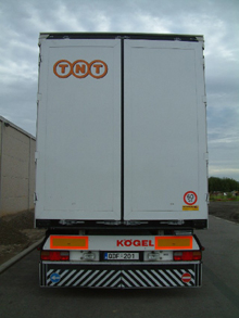 Here is the self-adhesive lettering on back doors of a TNT semitrailer
