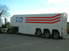 This tarpaulin was placed on a Guardian semitrailer with painted logos.