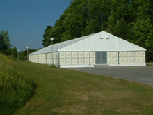Here is an aluminium marquee with rigid panels on the perimeter and flooring.