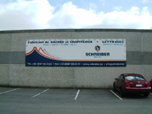 You can see here an advertising tarpaulin fixed on the Schreiber's company front.