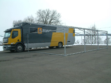 This aluminium awning was set up on a Renault semitrailer