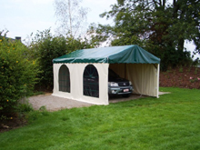 You have here a Schreiber party tent which has become a garage in Belgium.