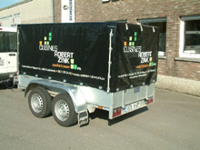 Here is a lettering on a tarpaulin for a small trailer