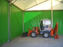 This warehousing aluminium structure with weather-boarding walls was set up in Ieteren