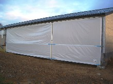 Here is a  Schreiber protection tarpaulin in a cowshed set up by our specialized technical teams