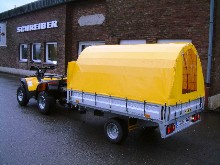 Here is a yellow children trailer towed by a quad bike