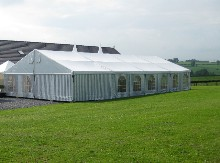 You have here a striped aluminium marquee situated in the countryside