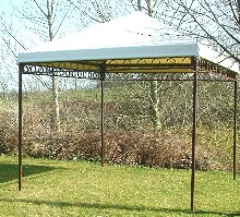 Party tent with decorative helix and powdered frame